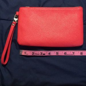 Express bright coral leather-like wristlet